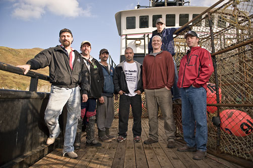 The crew of the Time Bandit on the deck of the Timebandit in Dutch Harbor Alaska