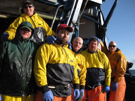 """F/V Trailblazer crew--Deckhand Chet Hamilton (green jacket), Deckhand/Engineer Monte Beck, Deckhand/Engineer Tristen Burris, Deckhand Victory Swan, Deckhand Scott Newman, Deckhand Scott """"Sky"""" Doar of the Trailblazer."""
